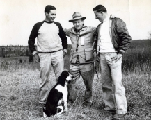 Here is Larry posing with his two sons. In this photograph, Jack (on left) and Stanley (on right). This is 1949, and Stanley is working with his father training and handling Springer Spaniels.