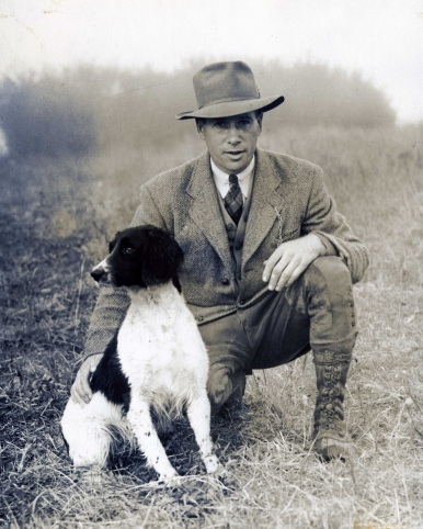 "Our history begins with Lawrence R. MacQueen and his wife, Agnes Boden Hay. The sailed from Scotland in the early 1930's and settled in Pottersville by the mid 1940's. Here is Larry with his first champion Field Trial pup, ""Staindrop Hurricane of Greenfair"" in 1942. Larry was an experienced and knowledageble handler for Laboradores and English Cocker Spaniels, and later making the switch to English Springer Spaniels."